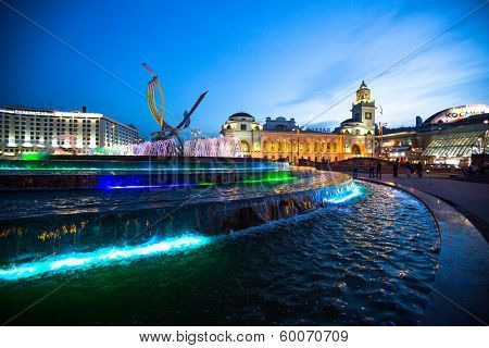 MOSCOW, RUSSIA - JUNE 14: View of Kievskiy railway station at night in June 14, 2012 in Moscow, Russia. Station was opened 1918 in the Byzantine Revival style pronounced in the 51 m high clocktower.