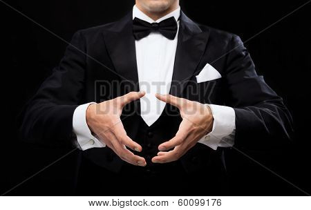 magic, performance, circus, show concept - magician showing trick