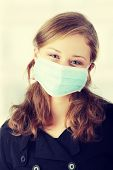 image of swine flu  - A model wearing a mask to prevent  - JPG