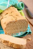 image of sorghum  - Homemade gluten free bread on a wooden table - JPG