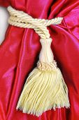 red curtain with tassel