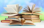 stock photo of short-story  - Stacks of books on table on natural background - JPG