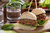 stock photo of veggie burger  - Vegan burgers with  beans and vegetables served in a poppy seed bun