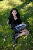 Young Lady In A Park With A Laptop