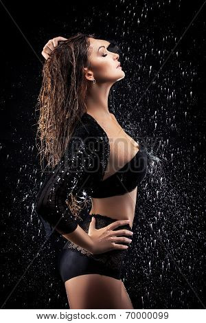 Portrait of young sensuality beautiful woman under the stream of water