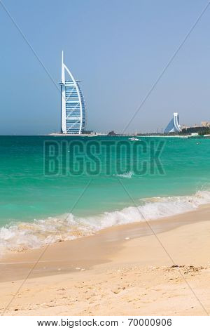 DUBAI, UAE - 2 APRIL 2014: Public beach Jumeirah in Dubai, UAE. Jumeirah Beach is a white sand beach that is located and named after the Jumeirah district of Dubai.