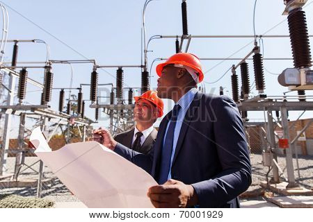 industrial managers working in electric substation