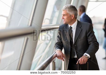 thoughtful senior business traveler at airport
