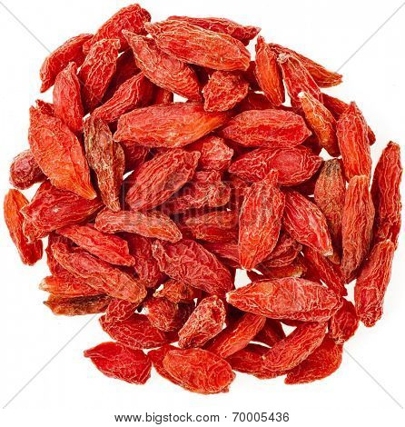 Goji berries. The addition to the tea beverage Surface Top View isolated on white background