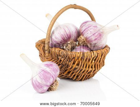 Garlic In A Wicker Basket, Isolated On White Background