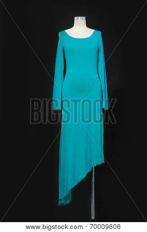 Blue evening gown on female mannequin on black  background