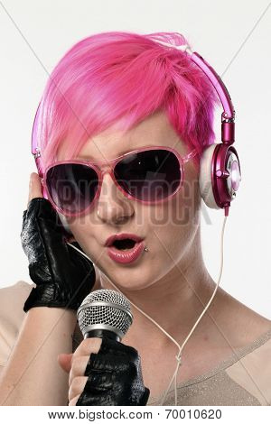 Punk woman singing and wearing headphones. Punk deejay red hairstyle woman