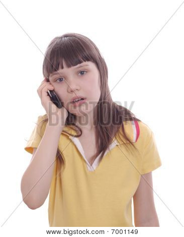 The Little Girl Talks By A Mobile Phone. Surprise