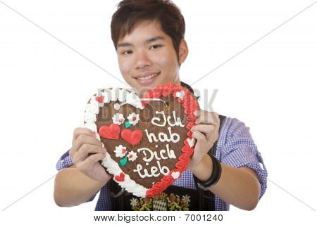 Happy man Holding Oktoberfest Heart In Camera And Smiles