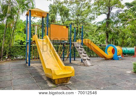 Children Playground With Sliders And Tunnel Leftover In The Park