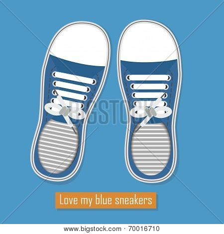 A pair of blue sneakers on blue background