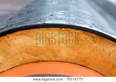 Insulation. Steel Pipe with Heat Insulation closeup.