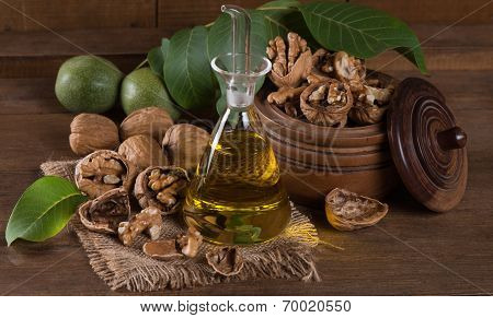 Bottle Of Walnut Oil And Nuts With Leaves