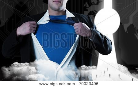 Businessman opening his shirt superhero style against business people going through keyhole door