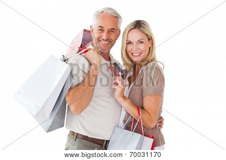 Happy couple holding shopping bags and credit card on white background