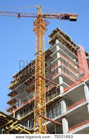 Crane and High-rise Building Under Construction.