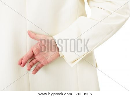 Businessman In White Suit With Crossed Fingers