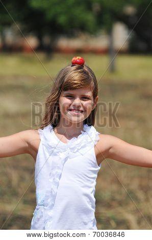 Happy Girl Balance With Apple On Her Head