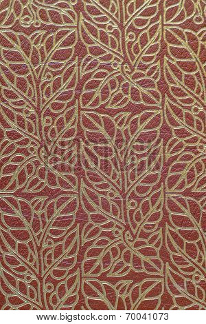 Gold leaves on tanned leather