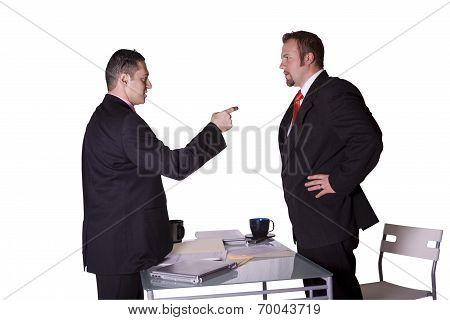 Businessmen Fighting Across The Desk