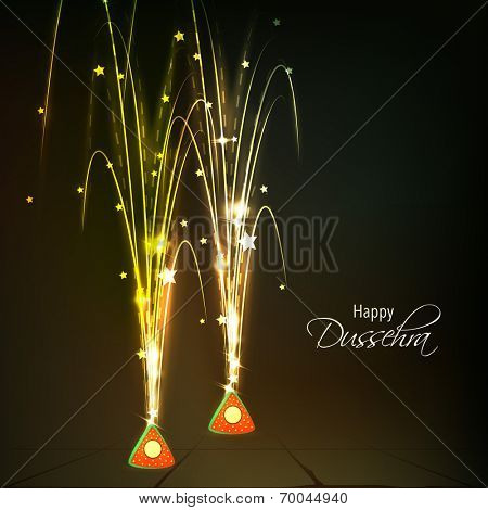 Beautiful images of red burning crackers and with spreading bright light and stars in night view background.