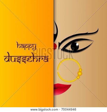 Beautiful half face of smiling Goddess Durga on wintage background with the stylish text to wish dussehra on shaded orange background.