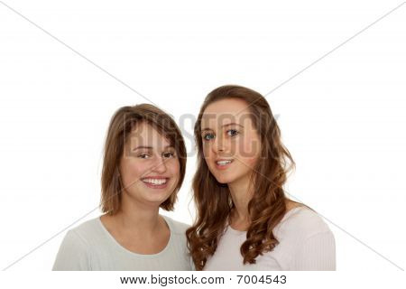 Two Cute Girls Smiling Together On White