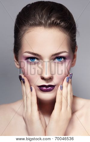 Young beautiful girl with stylish make-up and sparkly manicure