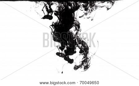 black ink dissolving in clear water