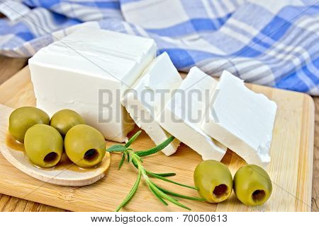 Feta With Olives And Rosemary On Board With Blue Cloth