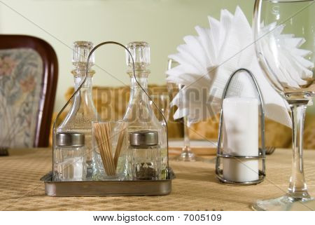 Salt,pepper Napkin And A Glass Are On The Table