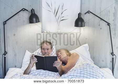 Senior woman and man in bed
