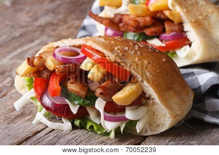 Two Doner Kebab With Meat, Vegetables And Fries In Pita Bread