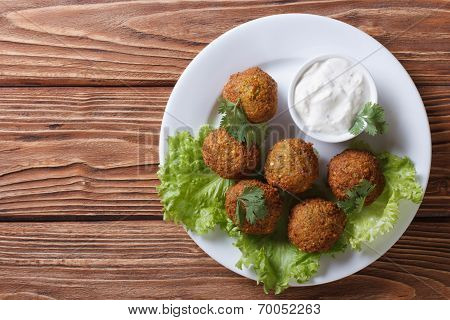 Falafel With Sauce Tzatziki Close-up View From Above