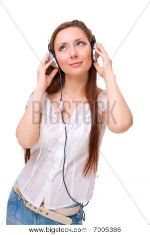 Girl In Headphones Listens To Music Looking Up