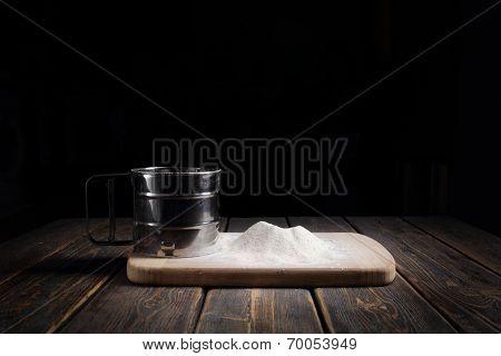 Sieve Flour On Wooden Table