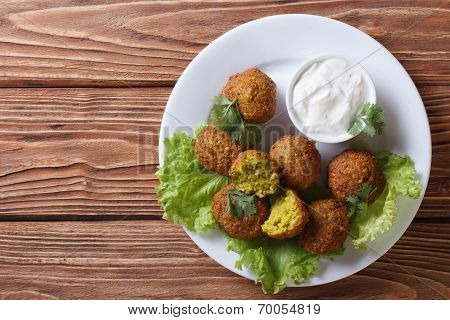 Delicious Falafel On Lettuce With Tzatziki Top View