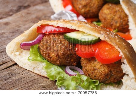 Falafel In Pita Bread Close-up On Wooden Table Horizontal