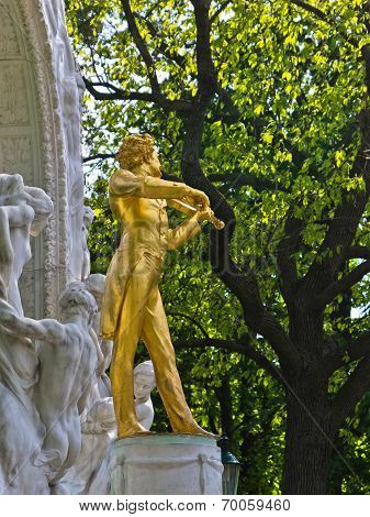 Golden statue of famous composer Johann Strauss at Stadtpark, downtown Vienna
