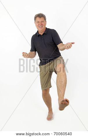 Full Length Portrait Of  Confident Barefoot Man In Blue Jeans