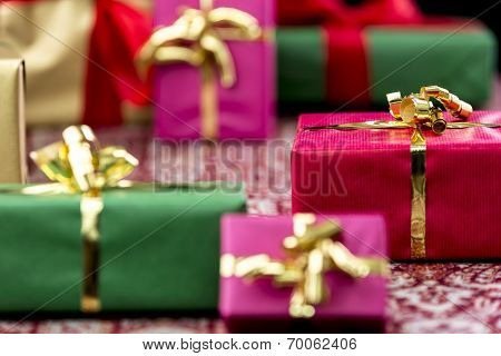 Wrapped Presents with Bows in Gold and Red