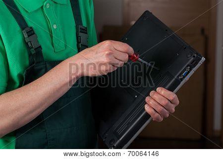 Mechanic Repairing Laptop