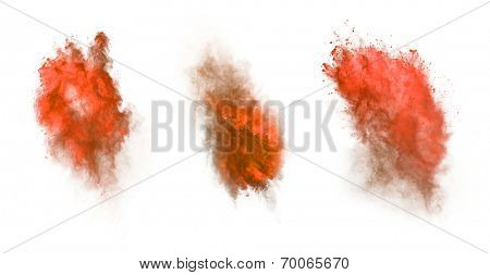 Freeze motion of red dust explosion isolated on white background