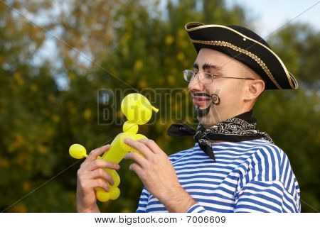 smiling handsome man in pirate suit looking at doggy air-ballon.