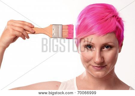 Woman painting her pink hairstyle.hairdressing pink paint..hairdresser pink coloring woman's hair